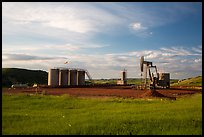 Oil pumpjack and tanks. North Dakota, USA ( color)