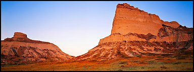 Cliffs glowing red at dawn,  Scotts Bluff National Monument. Nebraska, USA (Panoramic color)