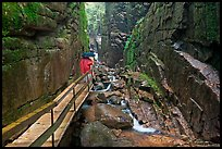 Visitors hiking the Flume in the rain, Franconia Notch State Park. New Hampshire, USA (color)