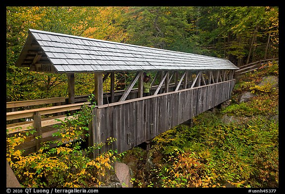 Wooden covered bridge in the fall, Franconia Notch State Park. New Hampshire, USA