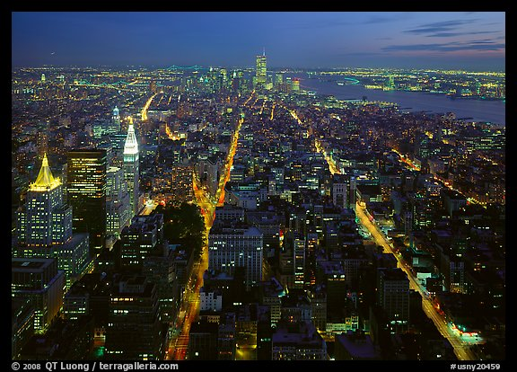 Streets at night from above with twin towers in background. NYC, New York, USA (color)