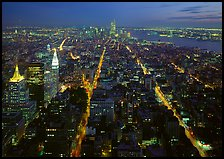 Streets at night from above with twin towers in background. NYC, New York, USA