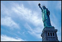 Statue of Liberty and pedestal against sky. NYC, New York, USA (color)