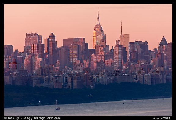 New York skyline  with Empire State Building, sunrise. NYC, New York, USA (color)