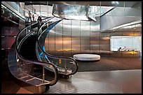 Curved moving staircase and meeeting room, Bloomberg building. NYC, New York, USA (color)