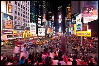 Crowds on Times Squares at night. NYC, New York, USA (color)