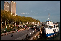 Tour boat along Battery Park, evening. NYC, New York, USA ( color)