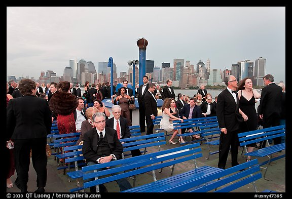 Black Tie gala guests on boat deck, New York harbor. NYC, New York, USA
