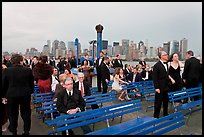 Black Tie gala guests on boat deck, New York harbor. NYC, New York, USA (color)