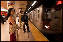 Young woman and arriving train on subway platform. NYC, New York, USA ( color)