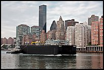 Barge on Hudson River and Manhattan waterfront. NYC, New York, USA
