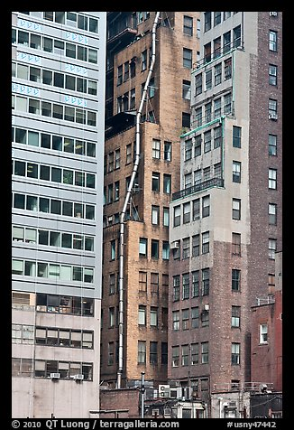 Old high-rise buildings with exterior pipe. NYC, New York, USA (color)