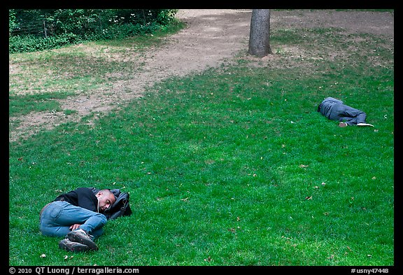 Men sleeping on lawn, Central Park. NYC, New York, USA