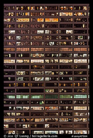 Multiple office spaces at night. NYC, New York, USA (color)