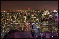 Woman on observation platform of Rockefeller center at night. NYC, New York, USA ( color)