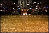 Rockefeller plaza and rink by night with Credo plaque. NYC, New York, USA (color)