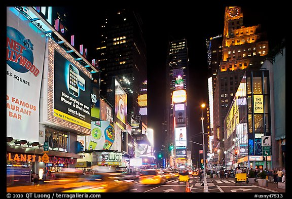 Taxis in motion, neon lights, Times Squares at night. NYC, New York, USA
