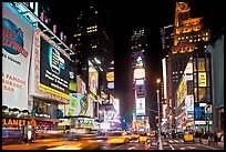 Taxis in motion, neon lights, Times Squares at night. NYC, New York, USA (color)