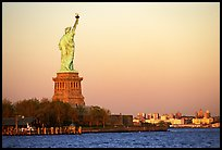 Statue of Liberty and Liberty Island from the back, sunset. NYC, New York, USA