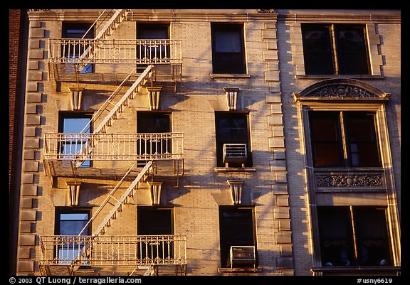 Residential building with emergency exit staircases. NYC, New York, USA (color)