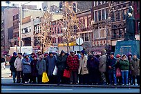 Gathering in Chinatown in winter. NYC, New York, USA (color)
