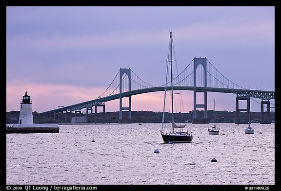 Newport Bridge and Newport Harbor lighthouse at sunset. Newport, Rhode Island, USA (color)