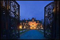 Entrance gate and historic mansion building at night. Newport, Rhode Island, USA ( color)