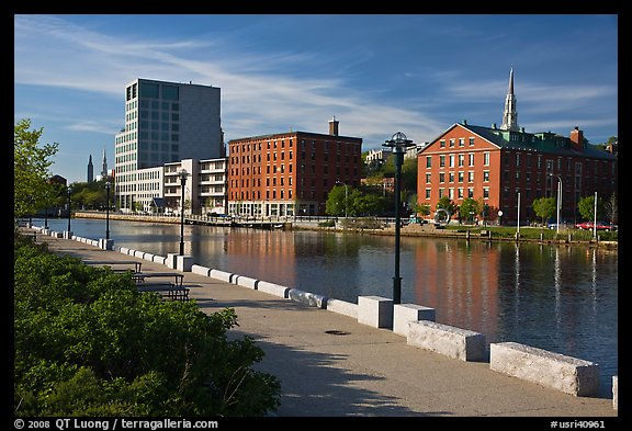 Brick buildings reflected in Seekonk river, late afternoon. Providence, Rhode Island, USA (color)
