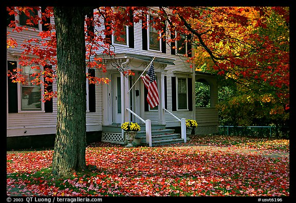 House with American flag and red leaves. Vermont, New England, USA