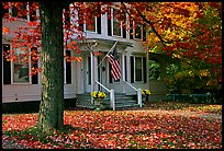 House with American flag and red leaves. Vermont, New England, USA ( color)