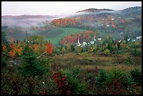 East Corinth village in fall with morning fog. Vermont, New England, USA