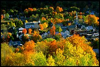 Village surounded by trees in brilliant fall colors. Vermont, New England, USA