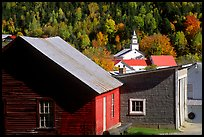 Red barn and East Topsham village in fall. Vermont, New England, USA