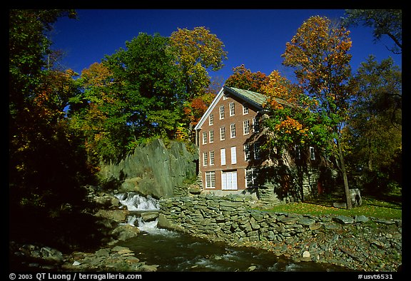 Old Mill next to a cascading brook near Stowe. Vermont, New England, USA (color)