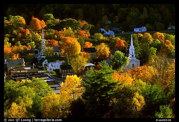 Village surounded by trees in brilliant autumn foliage. Vermont, New England, USA (color)