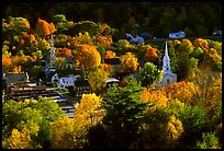 Village surounded by trees in brilliant autumn foliage. Vermont, New England, USA ( color)