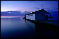 Lake Superior and wharf at dusk, Apostle Islands National Lakeshore. Wisconsin, USA