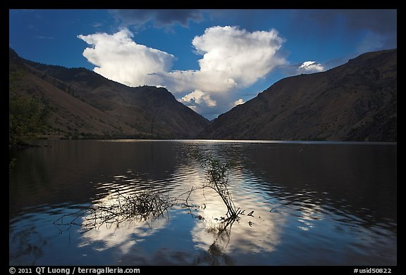 Thunderstorm clouds at sunrise reflected in reservoir. Hells Canyon National Recreation Area, Idaho and Oregon, USA (color)