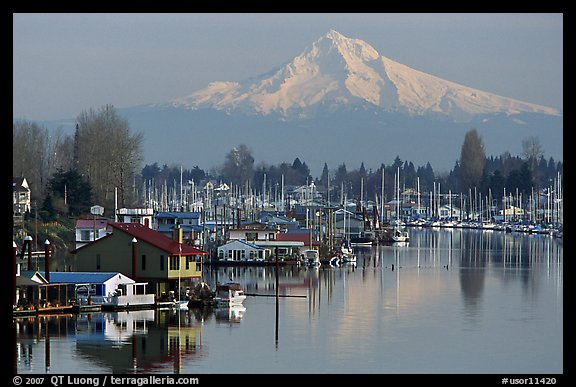 Houseboats on North Portland Harbor and snow-covered Mt Hood. Portland, Oregon, USA