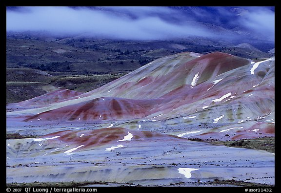Painted hills and fog, winter dusk. John Day Fossils Bed National Monument, Oregon, USA