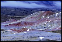 Painted hills and fog, winter dusk. John Day Fossils Bed National Monument, Oregon, USA (color)