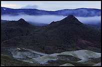 Buttes and fog at dusk. John Day Fossils Bed National Monument, Oregon, USA