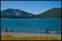 Family strolling on shore of East Lake. Newberry Volcanic National Monument, Oregon, USA (color)