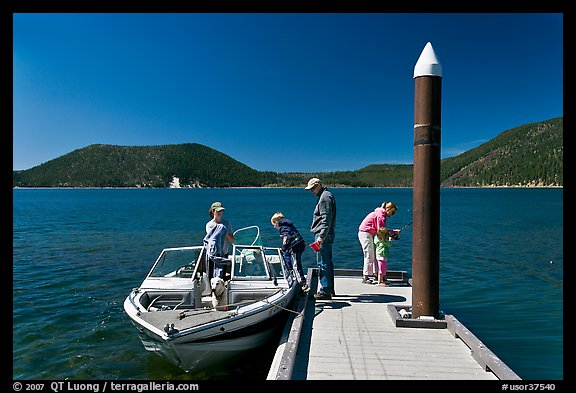 Family boarding boat, East Lake. Newberry Volcanic National Monument, Oregon, USA (color)