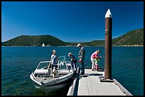 Family boarding boat, East Lake. Newberry Volcanic National Monument, Oregon, USA