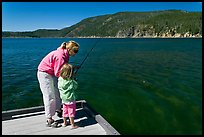 Mother and daughter on deck, East Lake. Newberry Volcanic National Monument, Oregon, USA