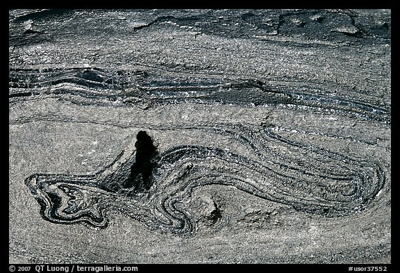 Incrustation pattern in obsidian glass close-up. Newberry Volcanic National Monument, Oregon, USA (color)