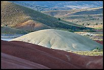 Bare ash mounds and sagebrush-covered slopes. John Day Fossils Bed National Monument, Oregon, USA