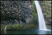 Woman in bikini at the base of Horsetail Falls. Columbia River Gorge, Oregon, USA (color)