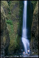 Men soaking at the base of Oneonta Falls. Columbia River Gorge, Oregon, USA